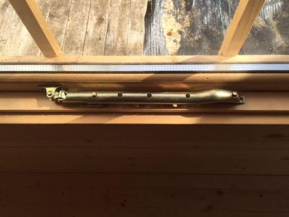Log Cabin window stay in it's final position.