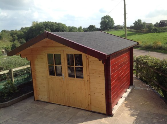 Peter log cabin in 34mm wall logs. 3m x 3m.