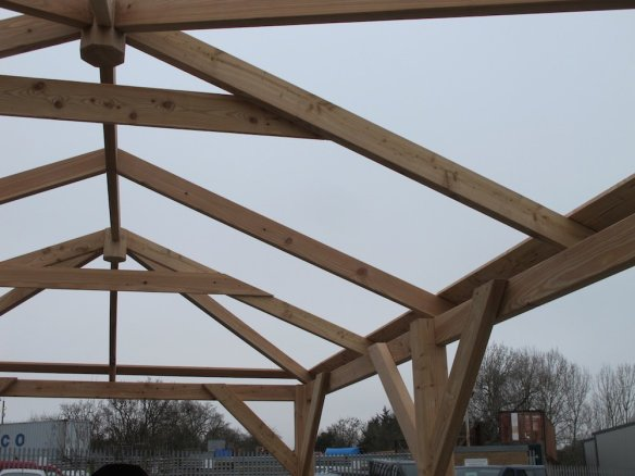 One roof board all the way around on the leading edge flush with the bottom of the rafter.