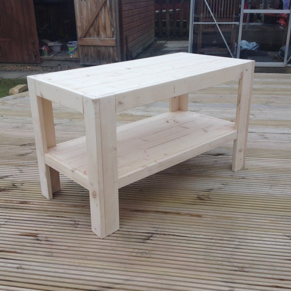 a coffee table for your log cabin made from leftover floor and roof boards