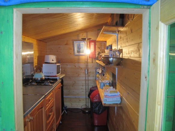 Coventry log cabin kitchen area is in the annexe to the side.