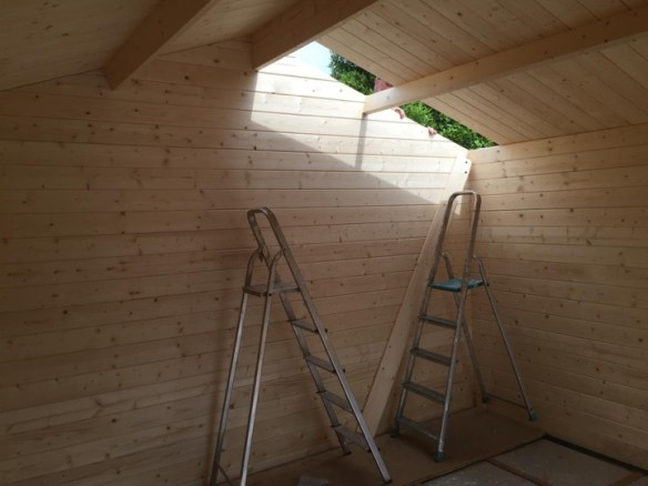 On a cabin of this size (3.8m x 3.8m) it takes about 90 minutes to board out the roof with two of you working on it.