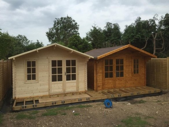 The Ulrik 'twins' log cabins. The wood is protected with 2 undercoats of Sikkens Cetol HLS plus and finished with a further 2 of Sikkens Filter 7 Plus in light oak.