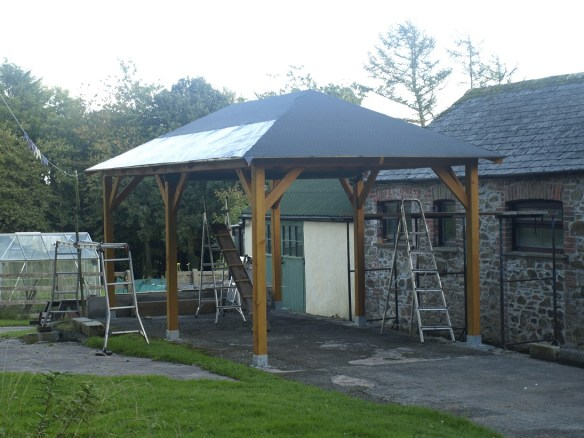 Gazebo roof shingles being fitted