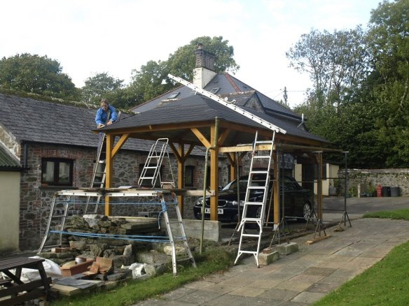 A good use of trestles and ladders to install the gazebo roof.