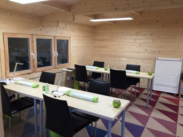 A step up from the 40 - 45mm log cabins. This is the Liverpool 58mm Log Cabin, VERY strong, very thermal efficient and a serious building. for serious uses, in this case it is a classroom.