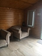 Seating inside the Ulrik Log Cabin