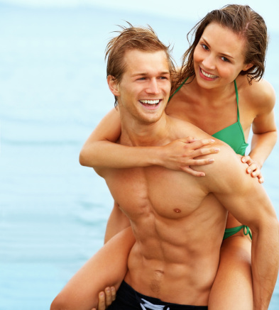 fit couple beach man woman