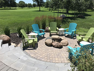 Hardscaped patio and fire pit are part of our landscape services.