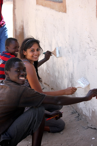 Amna and one of the students are having a great time painting a base