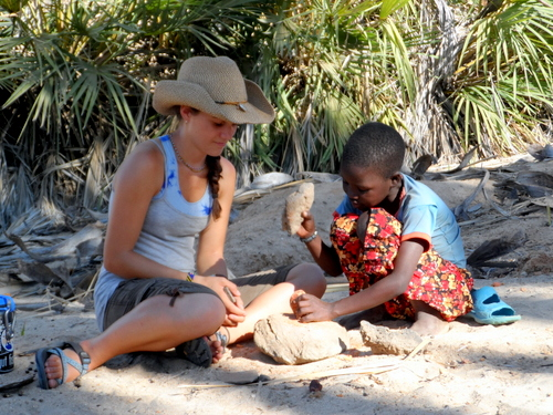 One of the Turkana girls shows Luisa how it's done
