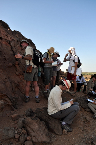 The students stop in the shade of an old fault-line.