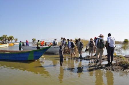 Students clamber into the boat at Kalokol fishil village.
