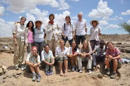At the end of the morning the students pose for a photo with the excavated bone at the bottom.