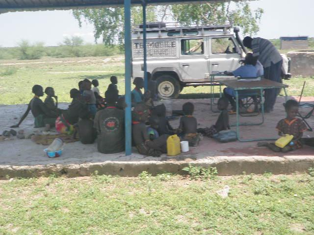 Mobile clinic staff attending to women and children
