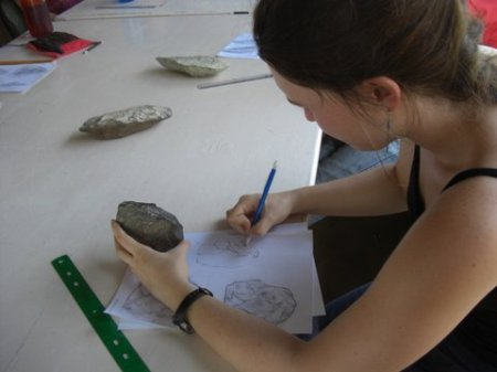 Alex employs extreme concentration as she draws her core.