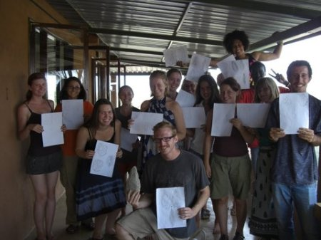 The talented group poses with their drawings, with Ned, Most Accurate winner, front and center.