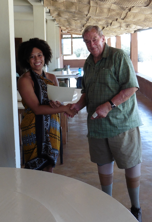 Melina being congratulated by Dr Leakey