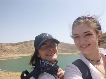 Jayde and Larisa take a selfie in along the crater rim of Flamingo Lake.  Note the flock of flamingos at the shoreline.