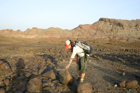Larisa examines the Middle Holocene stone pillar site.