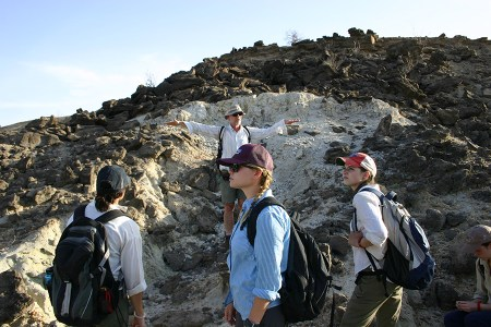 Dr. Feibel stands in front of the Lokochot Tuff dated at about 3.6 million years old. Here he describes what the landscape looked like when volcanic ash blanketed the landscape from the Ethiopian region.  This tuff has also been found in sediment cored from the Gulf of Aden.