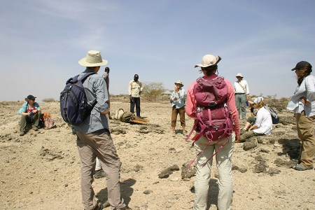 Dr. Leakey instructs students on how to set up the area to screen for fossilized bone fragments.