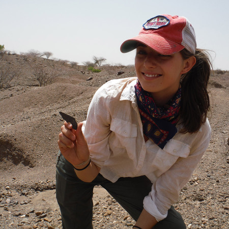 Larisa poses with a broken rock I found (not a stone tool). What does it look like to you?