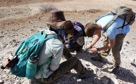 Kait, Rob and Niguss take carefully positioned GPS points to map the Chari tuff area.