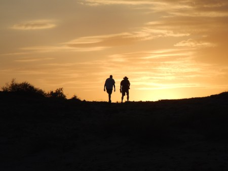 Dr. Dino Martins and Dr. Lawrence Martins hike into the sunset.