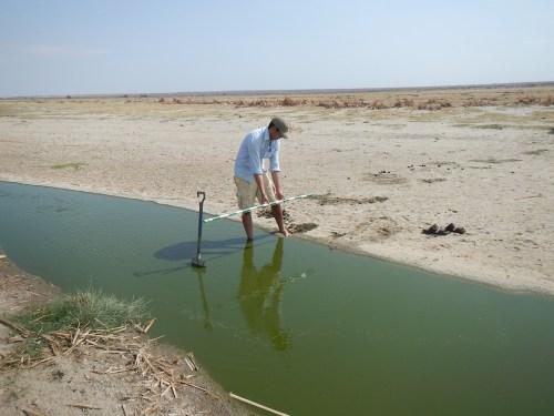 Max using his Jacob staff to measure the lagoon