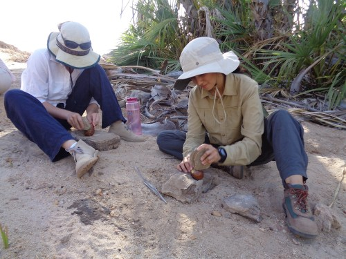 Natalie and Carla quickly pick up the proper methods used during nut processing