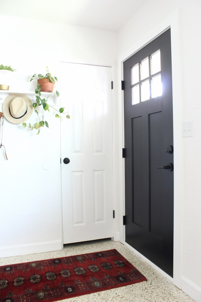 black door kwikset entry way
