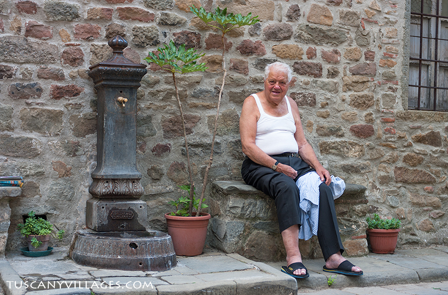 An italian man relaxing in the Piazza in Medicina