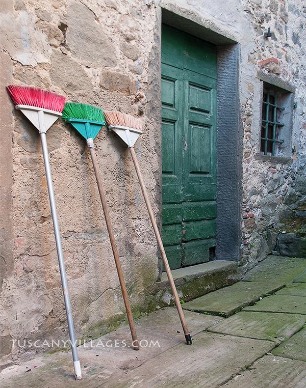 green-door-and-brooms
