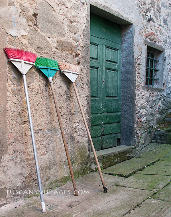 green-door-and-brooms