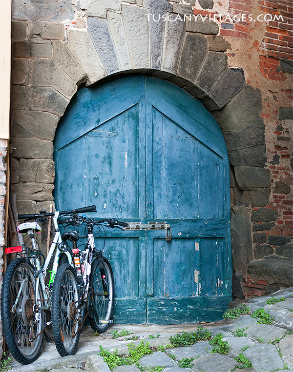 blue door and bikes, tuscany