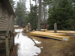 Shuffling the canoes from the dining hall to the canoe yard