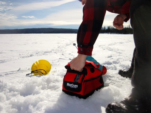 Ice fishing Marcum fish finder and NILS ice auger Tuscarora Lake Boundary Waters