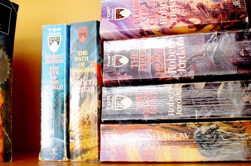 Books on shelf, wheel of time