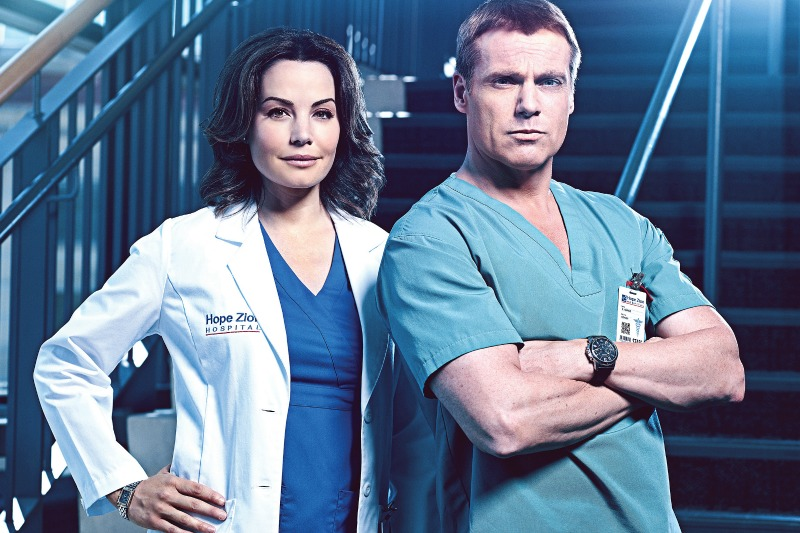 Erica Durance as Dr. Alex Reid, Michael Shanks as Dr. Charlie Harris