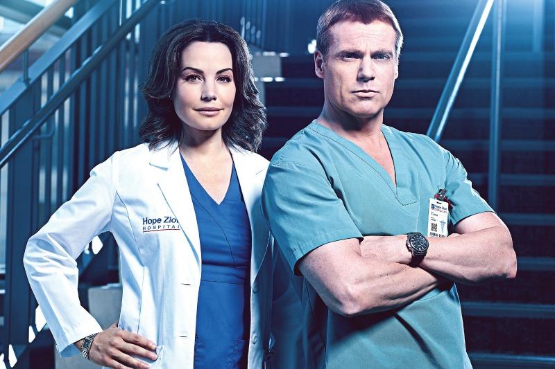 Erica Durance as Dr. Alex Reid, Michael Shanks as Dr. Charlie Harris