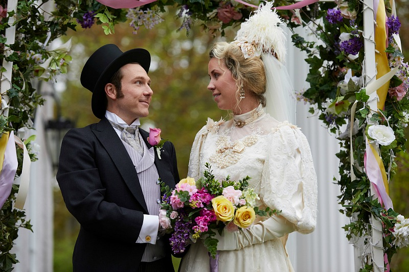 A man and woman stand at a wedding altar.