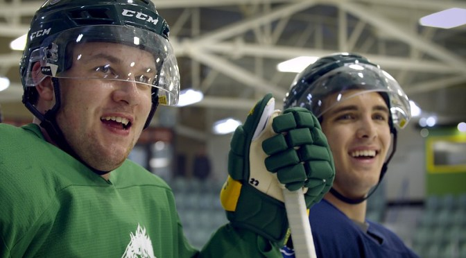 Two hockey players share a laugh.