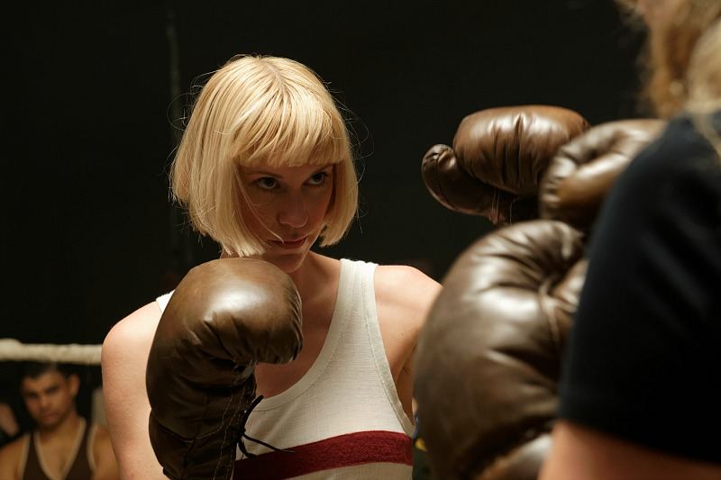 A woman in a boxing ring.