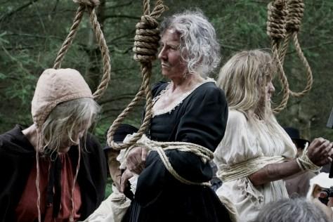 Three women have nooses around their necks.