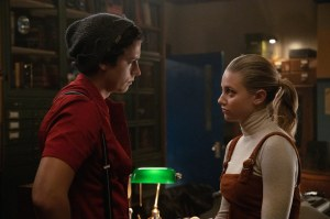 "Riverdale -- ""Chapter Sixty-Seven: Varsity Blues"" -- Image Number: RVD410a_0273.jpg -- Pictured (L-R): Cole Sprouse as Jughead and Lili Reinhart as Betty -- Photo: Jack Rowand/The CW-- © 2020 The CW Network, LLC All Rights Reserved."