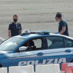 Tom and director Christopher on set near to the police cars