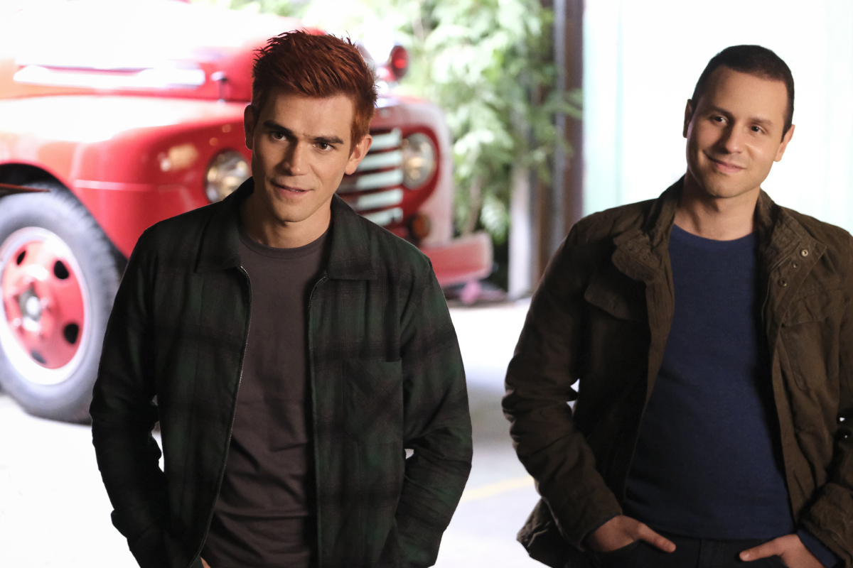 """Riverdale -- """"Chapter 83 - Eighty-Three: Fire In The Sky"""" -- Image Number: RVD507b_0104r -- Pictured (L-R): KJ Apa as Archie Andrews and Sommer Carbuccia as Corporal Eric Jackson -- Photo: Bettina Strauss/The CW -- © 2021 The CW Network, LLC. All Rights Reserved."""