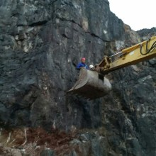 Clearing a rock face