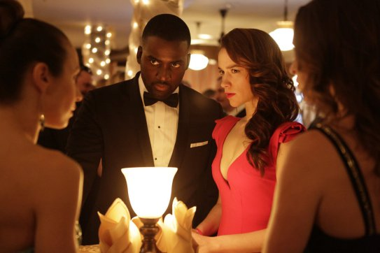 """WYNONNA EARP -- """"House of Memories"""" Episode 112 -- Pictured: (l-r) Shamier Anderson as Agent Dolls, Melanie Scrofano as Wynonna Earp -- (Photo by: Michelle Faye/Syfy/Wynonna Earp Productions)"""